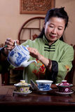 Chinese tea lady, traditionally dressed Stock Photo