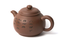 Chinese tea pot. Brown ceramic chinese tea pot on a white background Stock Image