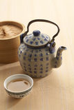 The chinese tea pot. With a dimsum Royalty Free Stock Images