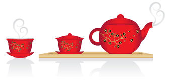 Chinese Tea Service. Chinese teapot and lidded cup on tray. Second cup without lid. Decoration is gold and black flowers on branch Stock Images