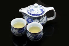 Chinese tea set. Chinese tea pot and cups on dark background Royalty Free Stock Photography