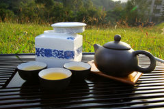 Chinese tea set. It is a set of teapot, tea and cups all together. They show Chinese culture Stock Images