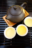 Chinese tea set. It is a set of teapot, tea and cups all together. They show Chinese culture Royalty Free Stock Image