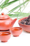 Chinese tea set. Chinese tea in clay cup close up with tea set and chinese tea leaves in a bowl Stock Images