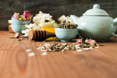 Chinese tea set with blue blossoms of roses, and green Royalty Free Stock Photo