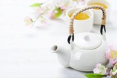 Chinese Tea Set and pink sakura blossom Royalty Free Stock Images
