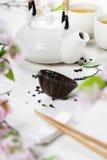 Chinese Tea Set and pink sakura blossom Stock Photos