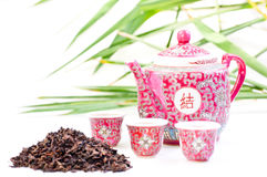 Chinese tea set  with tea leaves Stock Photos