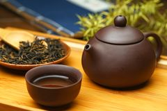 Chinese tea set,tea,teapot and cups on wooden plate stock images