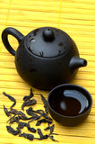 Chinese tea set and wild puerh on yellow mat Stock Photo