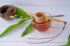 Chinese tea Shen Puer and Lily of the valley Royalty Free Stock Images