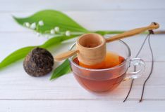 Chinese tea Shen Puer and Lily of the valley Stock Images