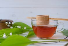 Chinese tea Shen Puer and Lily of the valley Royalty Free Stock Image