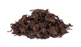 Chinese tea Shou Puer. Pressed fermented Pu-erh tea. Macro close up. Aromatic black puer tea. Healthy drink. Chinese tea Shou Puer. Pressed fermented Pu-erh tea royalty free stock photos