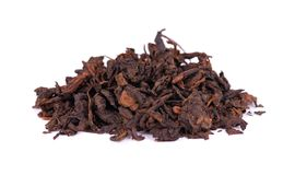 Chinese tea Shou Puer. Pressed fermented Pu-erh tea. Macro close up. Aromatic black puer tea. Healthy drink. Chinese tea Shou Puer. Pressed fermented Pu-erh tea royalty free stock photo