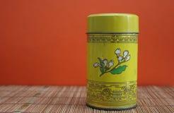 Chinese tea tin on bamboo mat Royalty Free Stock Image