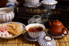 Chinese tea with traditional snack Stock Images