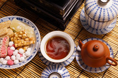 Chinese tea with traditional snack Stock Image