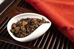 Chinese tea on wood plate. Background and rice paper Royalty Free Stock Photo