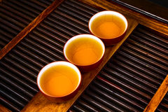 Chinese tea on wood plate Stock Photos