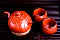 The Chinese teacups produced in City of Yixing. The Chinese teacups produced in City of Yixing are made of purple sand and clay cups royalty free stock photos
