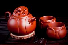 The Chinese teacups produced in City of Yixing. The Chinese teacups produced in City of Yixing are made of purple sand and clay cups royalty free stock images