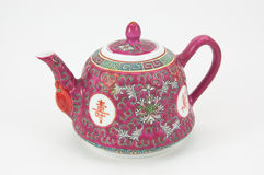 Chinese Teapot. A Chinese porcelain teapot with a white background Stock Photo