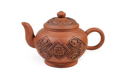 Chinese teapot. Simple Chinese clay teapot with Chinese character motifs and design on side and cover Stock Photos