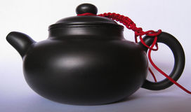 Chinese teapot. It is Chinese teapot with red wire Royalty Free Stock Photography