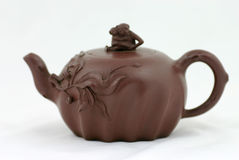 Chinese teapot. A teapot with Chinese art, flowers and monkeys Royalty Free Stock Photography