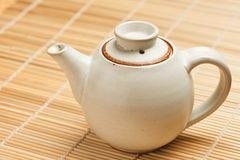 Chinese teapot on bamboo mat Royalty Free Stock Image