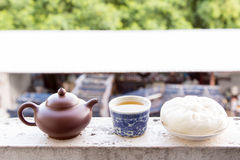 Chinese teapot and Chinese tea and dumplings streamed. Stock Photo