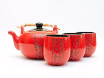 Chinese teapot with cups. Red Chinese teapot with cups for tea leaves of green tea Stock Photos
