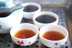 Chinese teapot and cups. Traditional chinese teapot and cups Royalty Free Stock Images