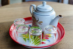 Chinese teapot and glass on chinese tray Stock Images