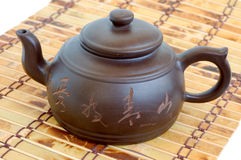 Chinese teapot on mat Stock Images