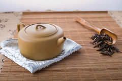 Chinese teapot, spoon and tea leaves Royalty Free Stock Images