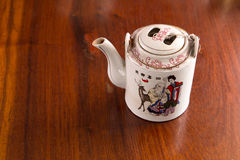 Chinese teapot. Chinese teapot on a table Stock Images
