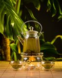Chinese teapot with tea, on a burning support from glass Royalty Free Stock Images