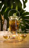 Chinese teapot with tea, on a burning support from glass Royalty Free Stock Photo