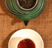 Chinese teapot with tea leaves and a cup Royalty Free Stock Photo