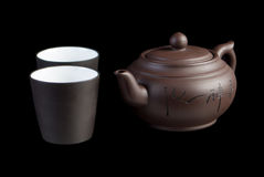 Chinese teapot with teacup. On black background Stock Photography