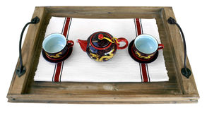 The Chinese teapot and two cups. Laying on a wooden tray of tea drinking for two Stock Photography