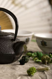 The Chinese teapot and two cups. On a canvas. Still-life Royalty Free Stock Photography