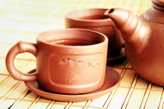 Chinese teapot, two cups and tea. Chinese clay teapot, two cups and green tea Stock Photo