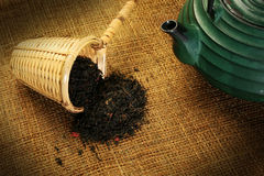 Chinese teapot and a wicker scoop Royalty Free Stock Photography