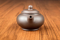 Chinese teapot on woden desk Royalty Free Stock Images