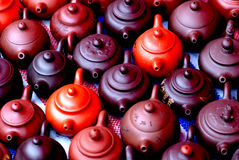 Chinese teapots. Boccaro ware,chinese teapots of different colors and forms and colors as red,crimson, Ochre and black Royalty Free Stock Photo