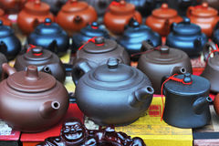 Chinese teapots and buddha Stock Photo