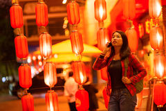 Chinese teenager with cell phone Stock Photography